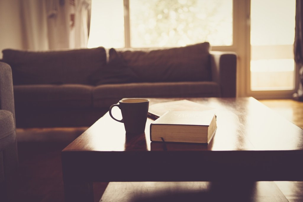 living room with book and coffee